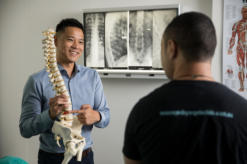 Sydney CBD Osteopath Dr Marcus Ng treating a slipped disc
