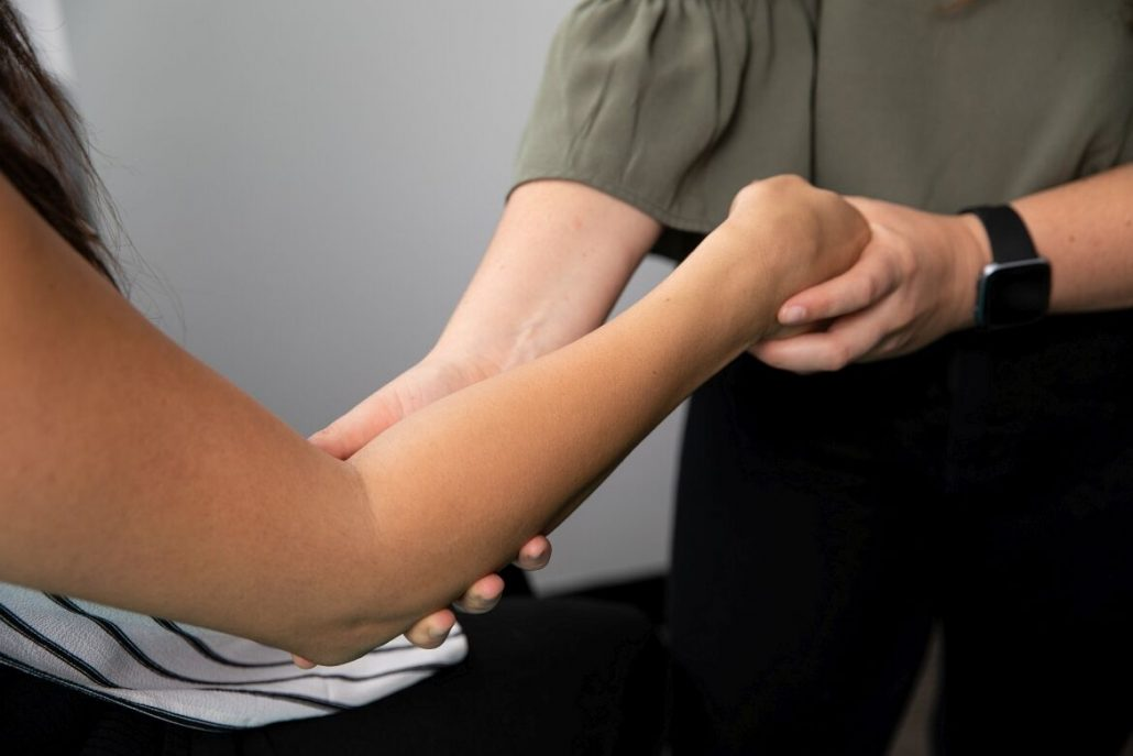 Osteopath or chiropractor assessing the wrist for a TFCC injury