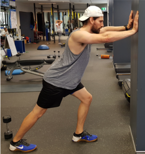 Physio performing calf stretch for achilles tendonitis