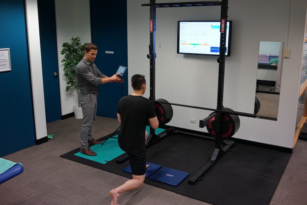Physio assesses lunge movement using functional axit screening technology in Sydney CBD