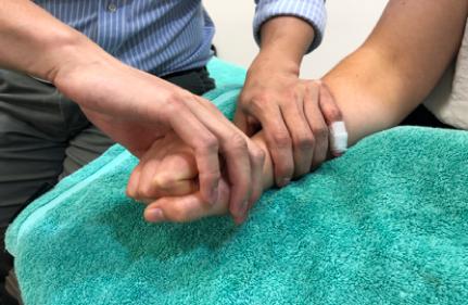 Sydney CBD chiro cozen test for tennis elbow pain