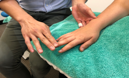 Sydney CBD chiro middle finger extension test for tennis elbow pain
