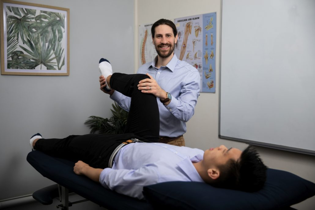 Physio Domenic Simeoni assessing knee joint for runners knee pain