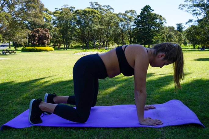 Sydney Physio Tenae demonstrates preparing for bear crawl for core muscles