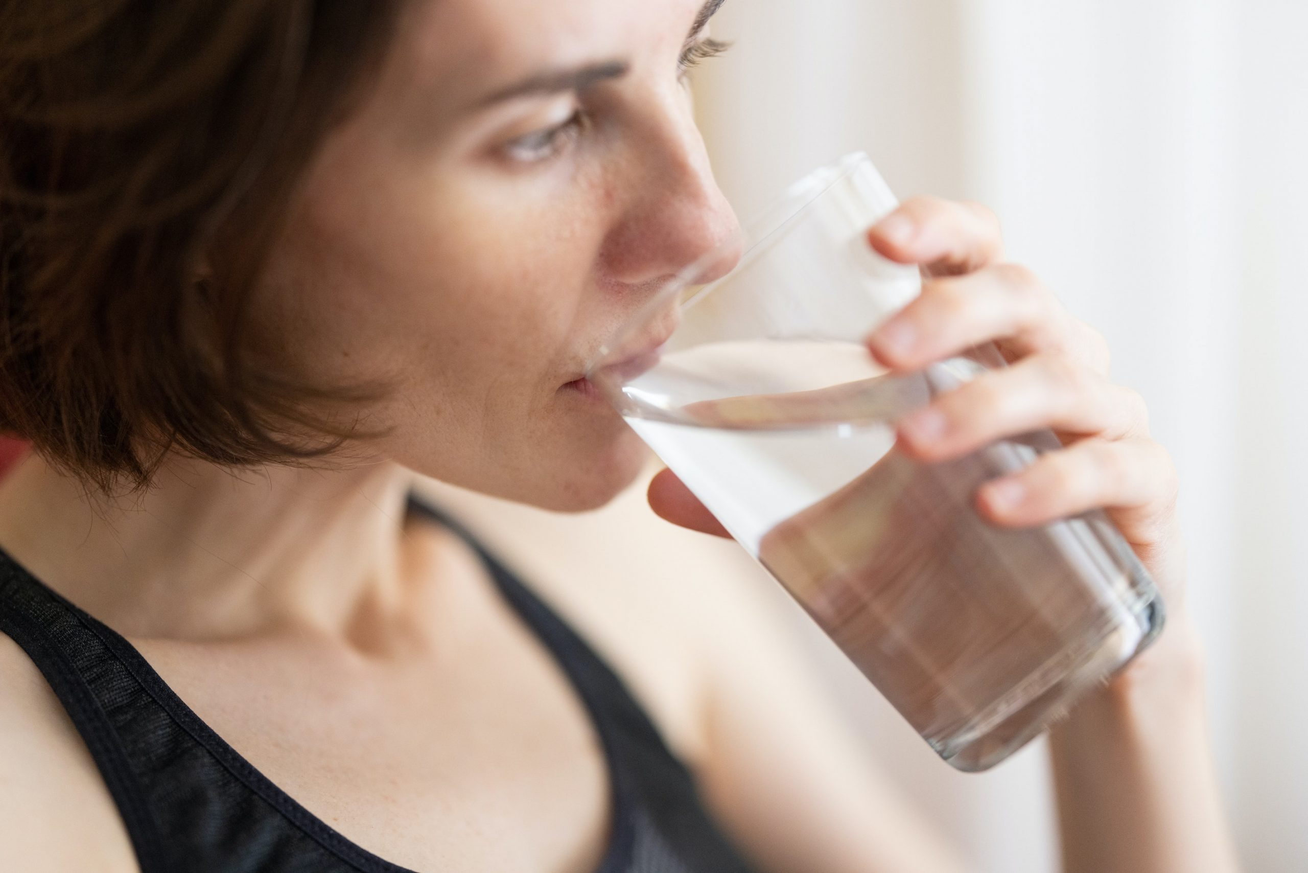 drinking water from glass